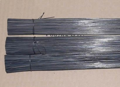 There are three bundles of cut wires with annealed finish in horizontal arrangement.