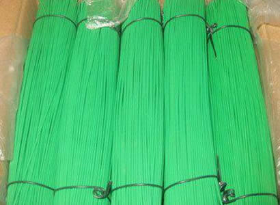 A box of green PVC coated galvanized straight cut wire packed with plastic bag.