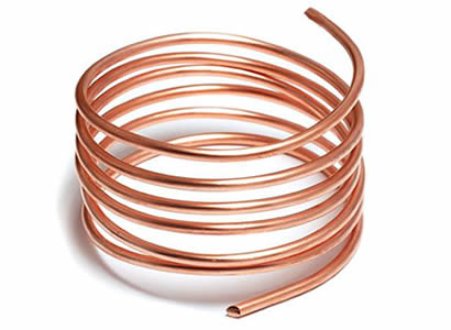 A roll of solid copper wire on white background.