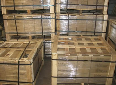 Several wooden boxes filled with straightened cut wire.